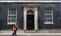 A road sweeper cleans up outside Number 10 Downing Street in London