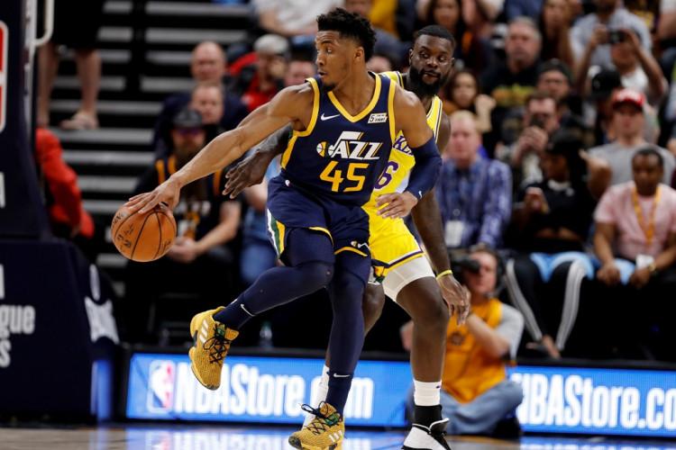 Utah Jazz guard Donovan Mitchell (45) puts a move on Los Angeles Lakers guard Lance Stephenson (6)