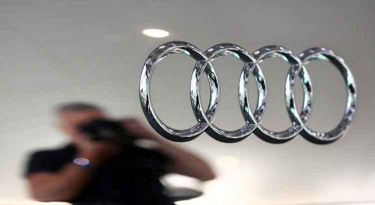 A photographer takes a picture of an Audi