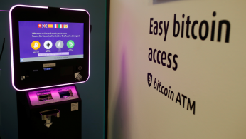The exchange rates of Bitcoin, Ether, Litecoin and Bitcoin Cash are seen on the display of a cryptocurrency ATM