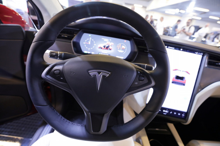 The logo of Tesla carmaker is seen inside a car at the Top Marques fair in Monaco