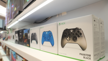 Xbox gaming controllers sit on a display shelf at Microsoft's new Oxford Circus store ahead of its opening in London