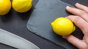 Person slicing a lemon